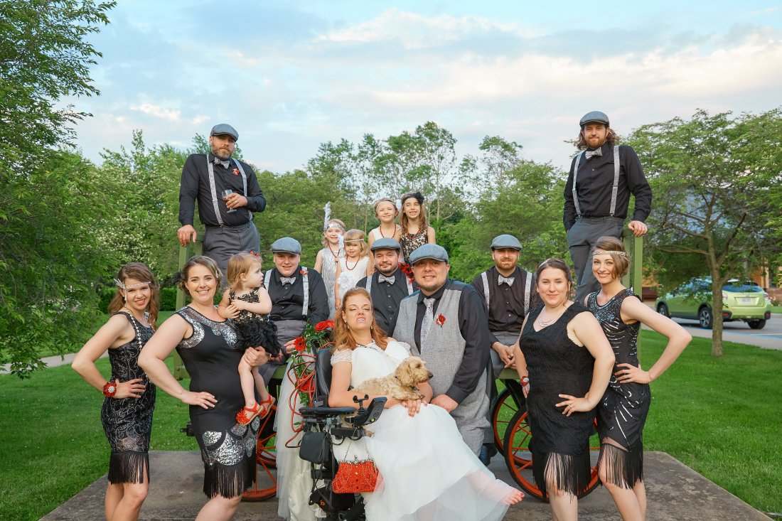 Josie Badger, one of her dogs, her husband, Mike, and their wedding party