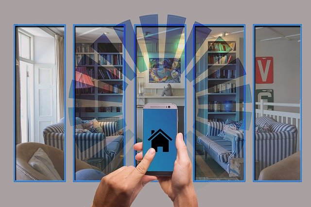Hands holding a cell phone with a house icon, and the graphic shows signals beaming out from the house in all directions -- this is superimposed on an image of a living room with furniture bookshelves, a painting on the wall, and an open French window